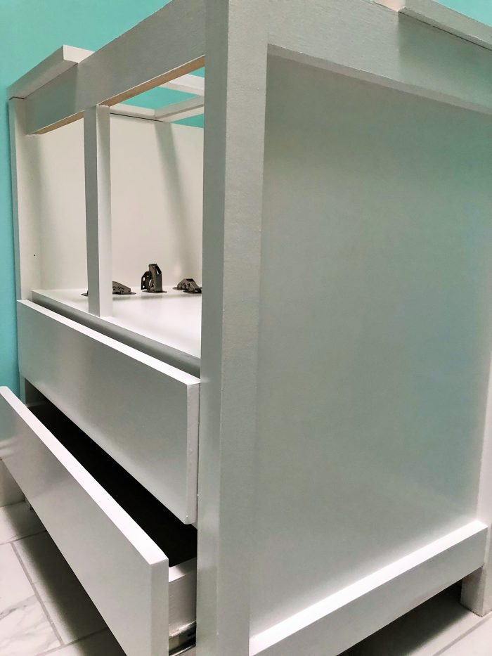 Single bathroom vanity with glass door